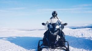 Person riding a snowmobile