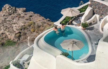 Couple in a small pool in Santorini