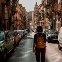 Lady walking down a street in Malta