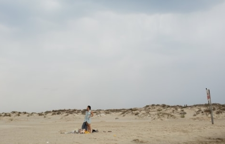 Woman standing on a beach in Zichron Yaakov, Israel