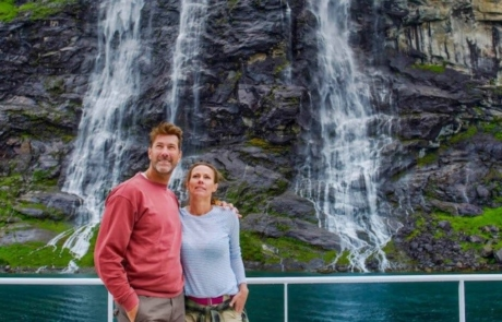 Couple standing with a Fjord in the background