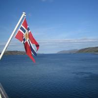 Norway flag hoisted on a Hurtigruten vessel