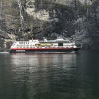 Hurtigruten vessel amongst Norwegian Fjords