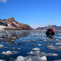 Boat with passengers in icy water