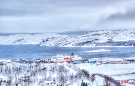 Cruise ship docked in snowy Kirkenes
