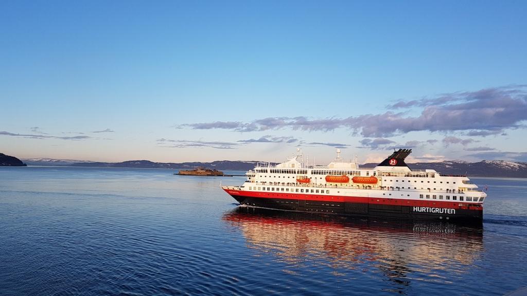 Hurtigruten ship cruising along Norway