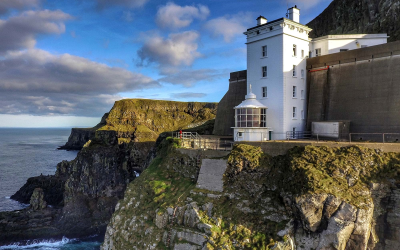 Building on a cliff side overlooking the ocean