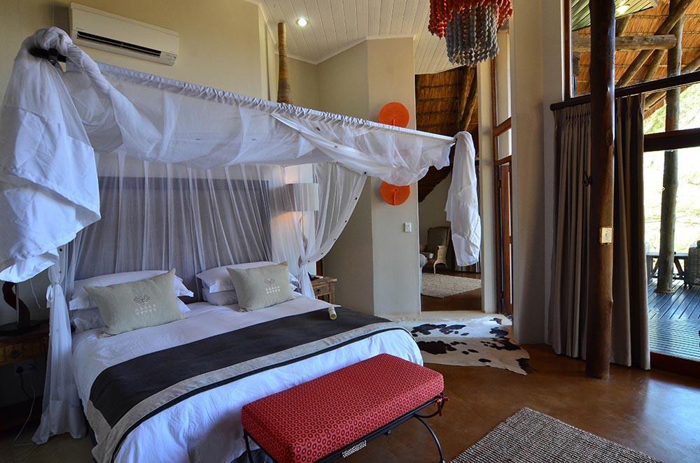 Bedroom of a river suite