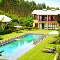 Outdoor Area with pool and chairs