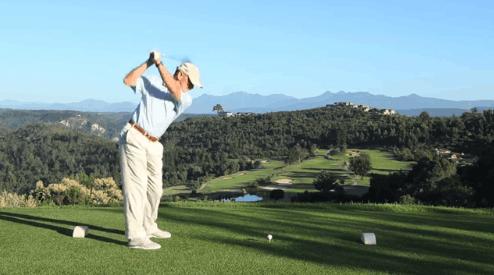 Male golfer teeing off in golf