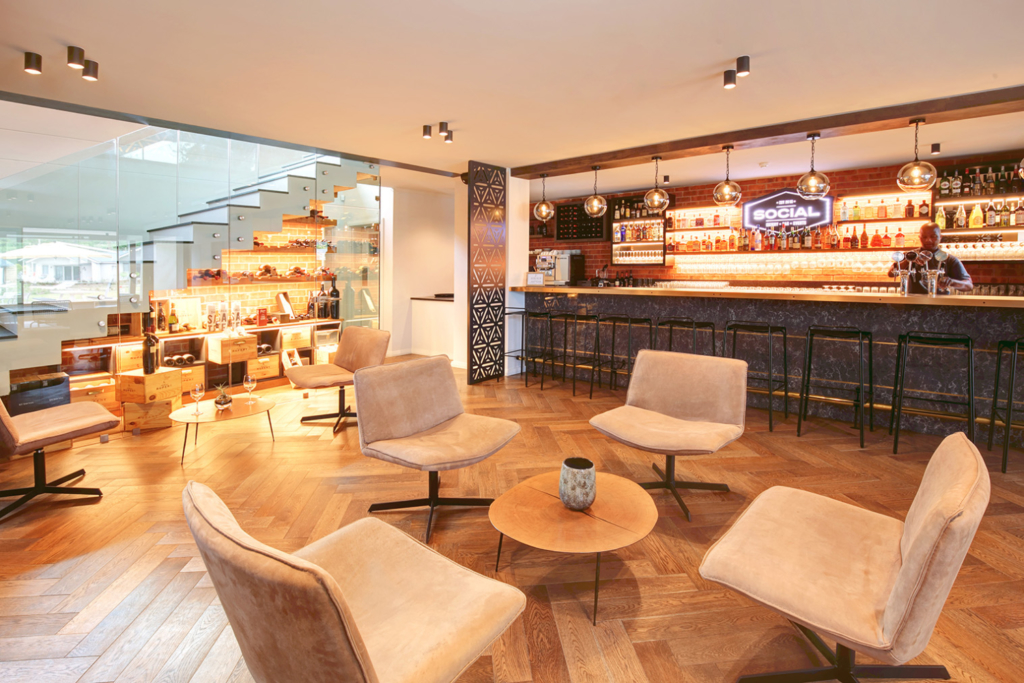 Panoramic view of a social area and bar indoors