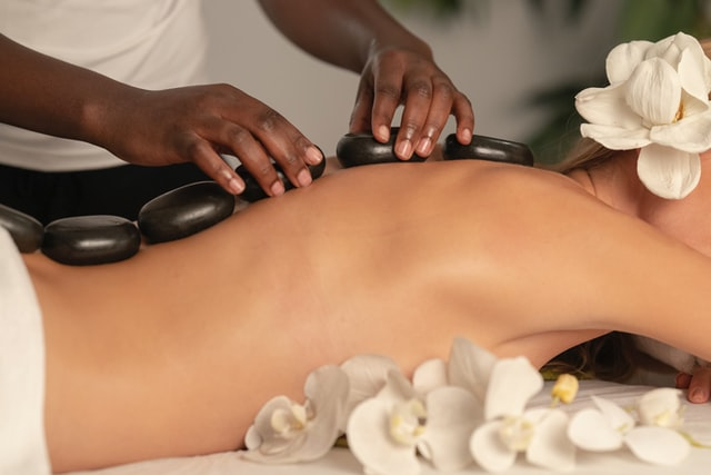 Woman with hot rocks on her back at a spa