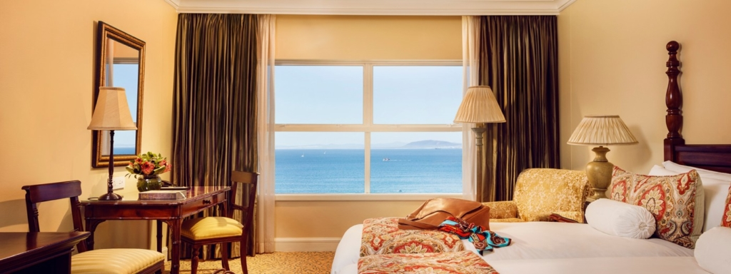 Luxury room with ocean view out the window