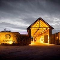 Large entrance into a lodge with gloomy skies