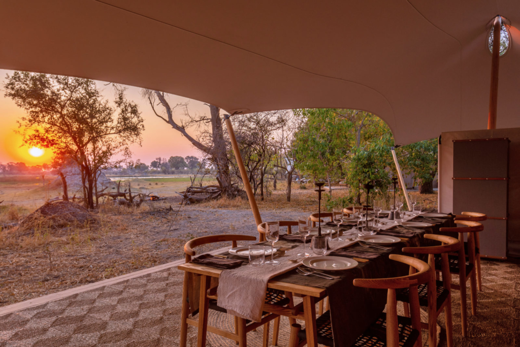 Dinner at a safari camp with a sunset