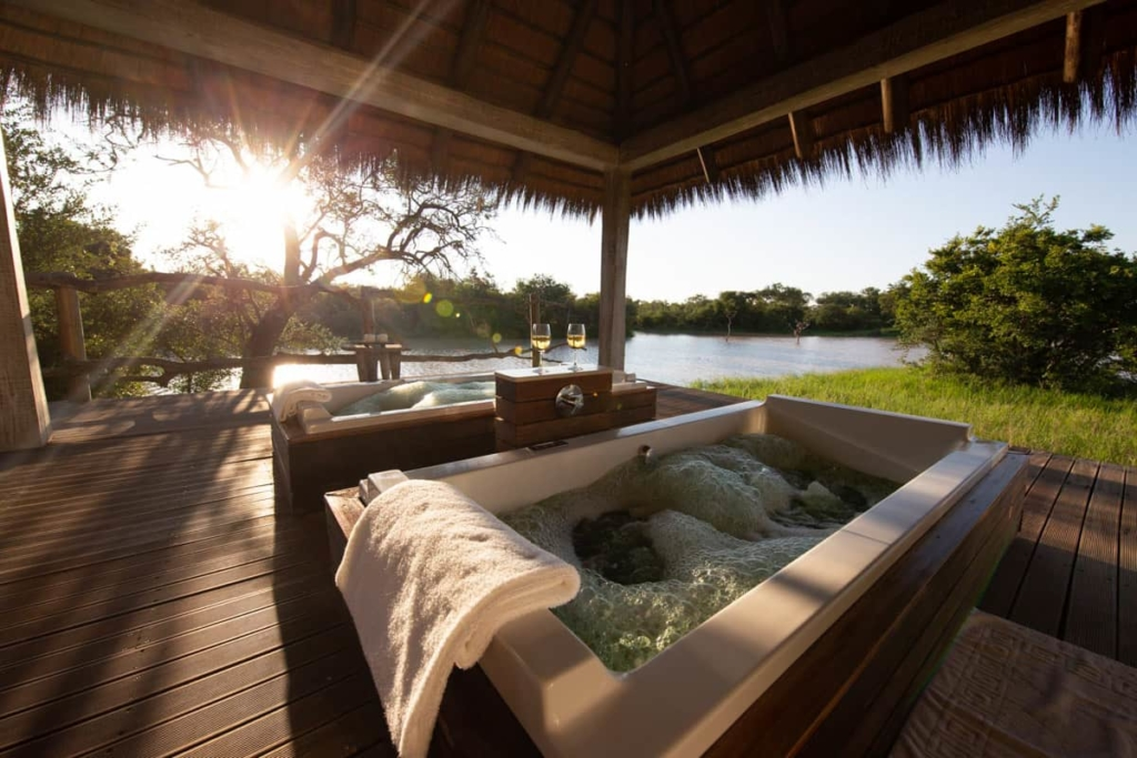 Jacuzzi with Champagne in glasses overlooking a river