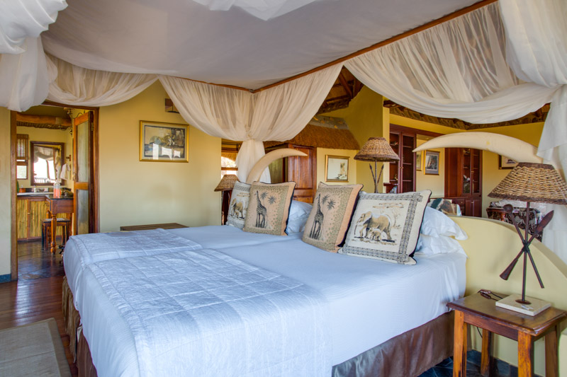 Room with draping over the bed