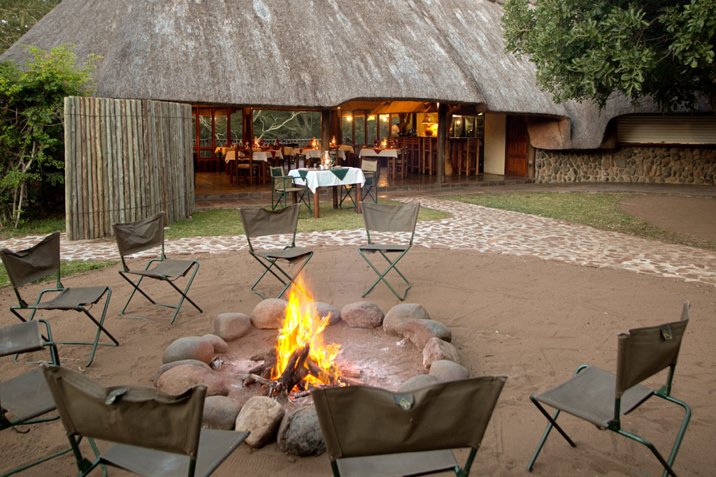 Fire boma with a lit fire and seats around it
