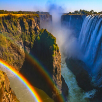 Large waterfall gorge with a rainbow