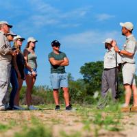 People talking in a group on a safari walk