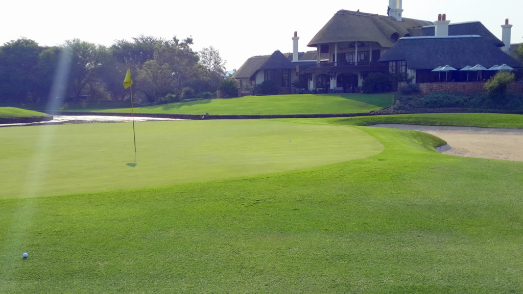 Green on a golf course with the clubhouse in the background