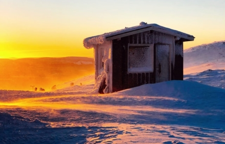 Sun glazing on a cabin in Lapland