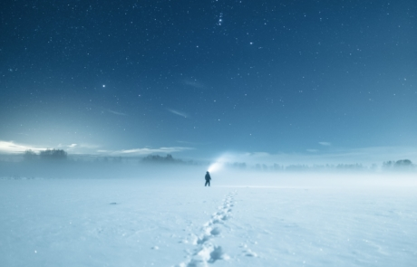 Man walking in thick snow in lapland